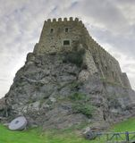 Fortress on a rock mountain stock photos