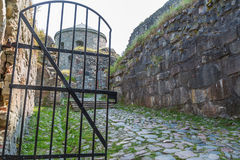 Fortress ruin and a iron gate Royalty Free Stock Photos