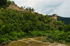 Fortress ruins on the hil, covered by forest Royalty Free Stock Images