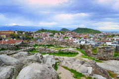 Fortress ruins of Plovdiv Old Town. Scenic view of Plovdiv old town,ancient fortress ruins on the hilltop and the Rodopes mountain in the distance against Royalty Free Stock Image