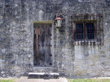 Fortress Side Door. Small side door and barred window of the fort at Goliad State Park in Goliad, Texas Stock Photography
