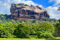 Fortress of Sigiriya Lion Rock against the sky with clouds royalty free stock photography