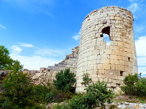 Fortress Suresnes. Crimea. Middle Ages. The ruins of the tower and the remains of the fortress wall. Against the background of blue sky among the bushes and Stock Image