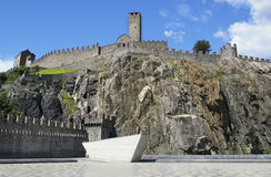 Fortress in switzerland town on rock. Stone fortress in bellinzona switzerland town on rock top walls and defense tower Stock Photo