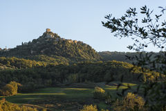 The Fortress of Tentennano above the orchard in a small hamlet in Castiglione d'Orcia Stock Images