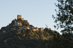 The Fortress of Tentennano above the orchard in a small hamlet in Castiglione d'Orcia Royalty Free Stock Images