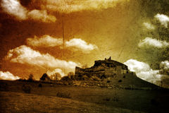 Fortress - toned picture. In retro style with paper texture Stock Photos