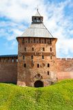 Fortress tower of red brick and wall Stock Images