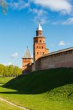 Fortress tower of red brick and wall Royalty Free Stock Photo