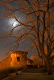 A Fortress Wall. A tumbledown wall of an old fortress in night light and the moon Stock Photo