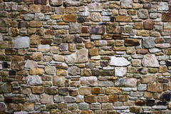 Fortress wall. Made from rocks stock images