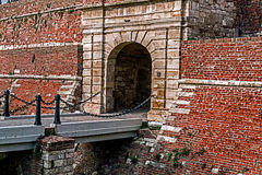 Fortress wall with bridge at entrance Royalty Free Stock Photography