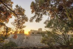 The fortress wall in the harbor at sunset. Rhodes Royalty Free Stock Image