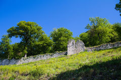 Fortress wall and tower of the ancient castle Stock Images