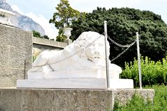 Sculpture of a lion of marble at the entrance to the Vorontsov Palace. Crimea. Fortress wall and the tower of the Vorontsov Palace. Crimea. Alupka stock image