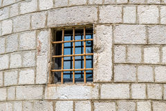 Fortress wall window with iron rod Stock Image