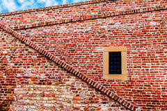 Fortress wall with window and stairs Stock Images