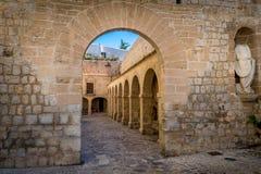 Fortress walls. Medieval Dalt Vila fortress arch gate, columns and statue. Eivissa, Spain Stock Photos