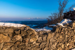 Fortress walls and mountains in background. Winter landscape from the walls of a fortress royalty free stock photos
