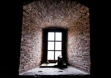 Fortress Window and thick brick wall. Light and hope concept Royalty Free Stock Images