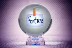 Fortuna, palavras na esfera de cristal mágica Fotografia de Stock Royalty Free
