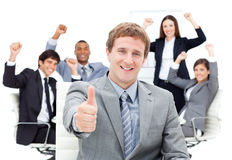 Fortunate business team punching the air Royalty Free Stock Photography