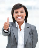 Fortunate business woman with a thumb up Royalty Free Stock Photo
