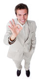 Fortunate businessman showing OK sign Stock Photography