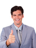 Fortunate businessman with thumb up Royalty Free Stock Image