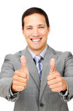 Fortunate businessman with thumbs up Royalty Free Stock Images