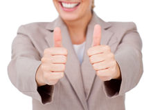 Fortunate businesswoman with thumbs up Royalty Free Stock Images