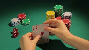 Fortunate poker player checking cards, getting chance to win game with two aces. Stock footage stock video