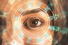 Fortune and abstract concept. Close up of eye with horoscope wheel. Fortune and abstract concept. Double exposure stock photography