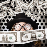 Fortune 500 businessman covered in US dollars Stock Photography
