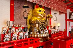 Fortune cats Nameki Neko in temple in Noboribetsu Date JIdaimura Historic Village at Hokkaido, Japan.  Royalty Free Stock Images