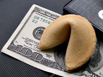 Fortune cookie on 100 bill Stock Photos