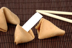 Fortune Cookie. Broken fortune cookie with a blank fortune Stock Photo