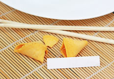 Fortune Cookie. With blank white space next to chopsticks plate and bamboo placemat Stock Photography