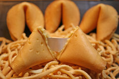 Fortune Cookie. The fortune cookie is a crisp cookie made from flour, sugar, butter, vanilla, and milk with a fortune wrapped inside. A fortune is a piece of Stock Image