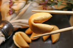 Fortune Cookie. The fortune cookie is a crisp cookie made from flour, sugar, butter, vanilla, and milk with a fortune wrapped inside. A fortune is a piece of Stock Photo