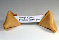 Fortune Cookie. With the expression: marriage is grand, divorce is a hundred grand Royalty Free Stock Photo
