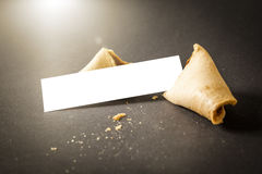 A fortune cookie with a blank paper for your message Royalty Free Stock Image