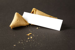 A fortune cookie with a blank paper for your message Stock Images