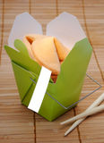 Fortune Cookie Box. Chinese Fortune Cookies In A Green Take Out Box With A Blank Sign Ready For Your Message Royalty Free Stock Photos