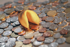 Fortune cookie & Coins Royalty Free Stock Photos