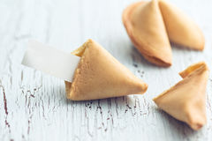 Fortune cookie on the cracked table Royalty Free Stock Photo