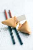 Fortune cookie on the cracked table Stock Photos