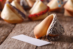 Fortune cookie decorated with black and white chocolates macro Stock Images