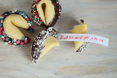 Fortune cookie decorated with chocolate. Fortune cookies decorated with chocolate it will turn out all right in the end Royalty Free Stock Photography
