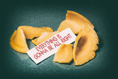Fortune Cookie Everything is Gonna be All Right. A cracked open fortune cookie from a Chinese restaurant with the phrase, Everything is Gonna be All Right royalty free stock image